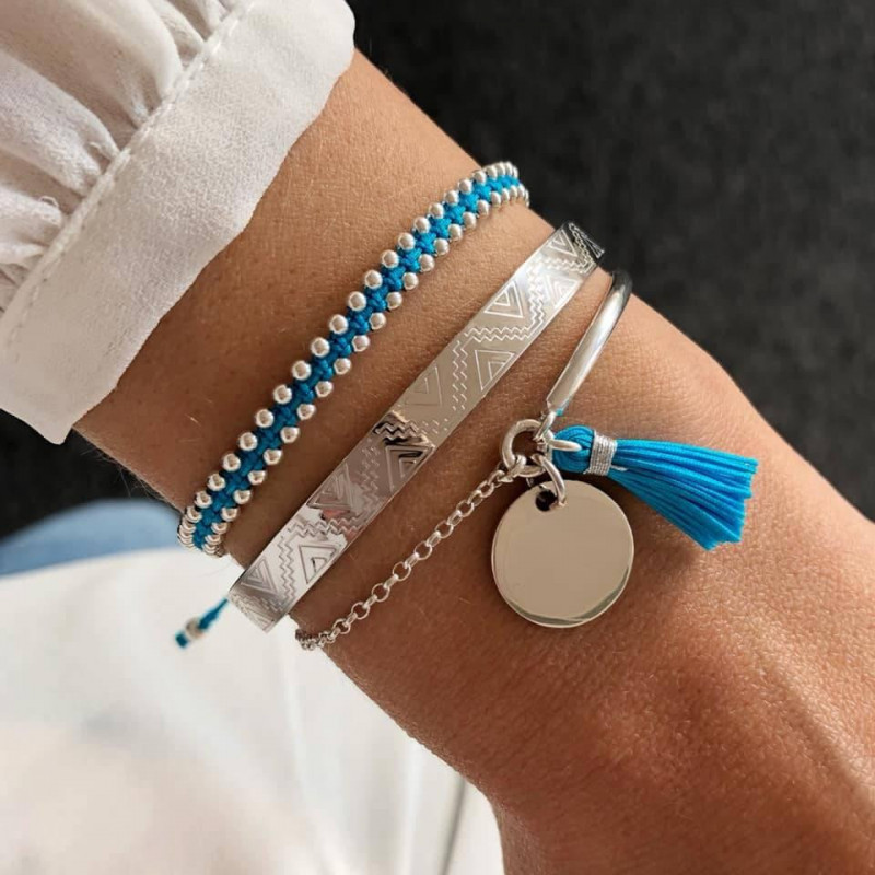 Turquoise blue braided bracelet with beads