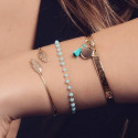 Lock bangle with pompom and medal