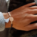 Lock bangle with suspended medal and pompom
