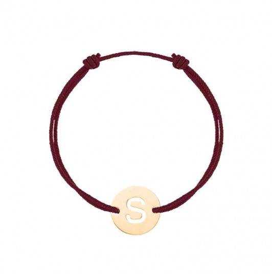 Tie bracelet with perforated initial