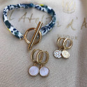 Gold-plated hoop earrings with small hammered medal