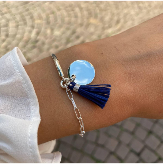 Half bangle and large link chain bracelet with medal and pompom