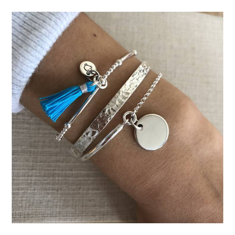 Silver beads and tubes bracelet with pompom