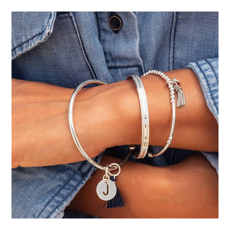 Silver beads and tubes bracelet with silver pompon