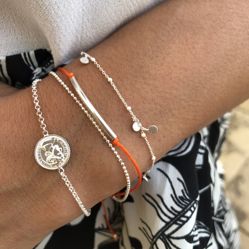 Chain bracelet with small oranges beads and medals
