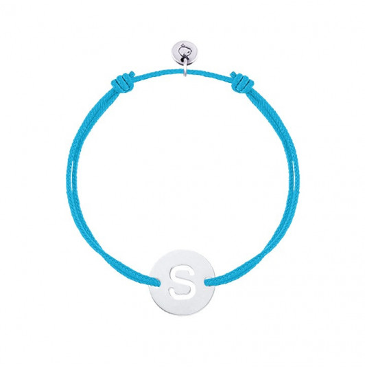 Tie bracelet with perforated initial letter