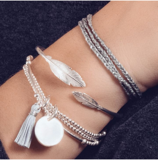 Silver and feather combination