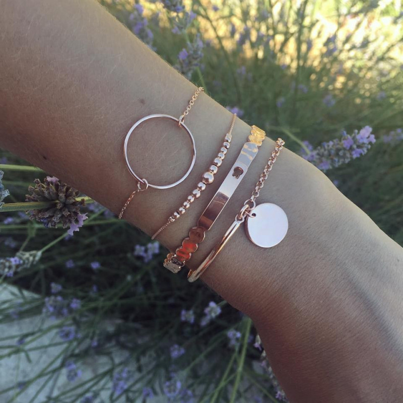 Wavy hammered rose gold-plated lock bangle