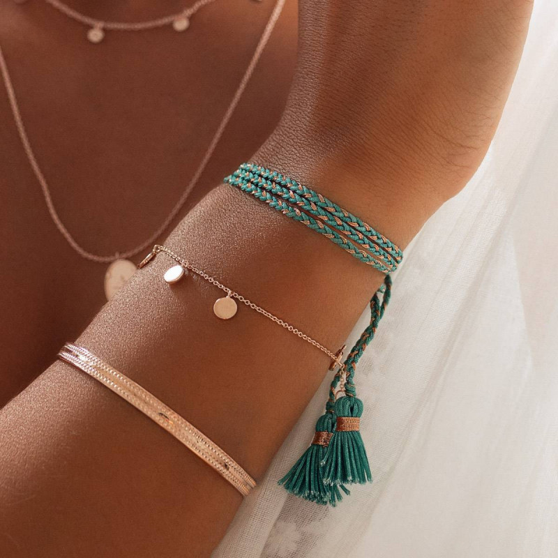 Rose gold-plated turquoise green triple braided tie bracelet with pompoms