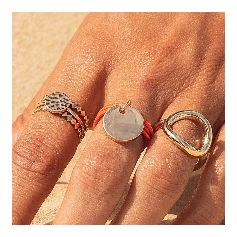 Multiple string ring with small thick gold-plated medal