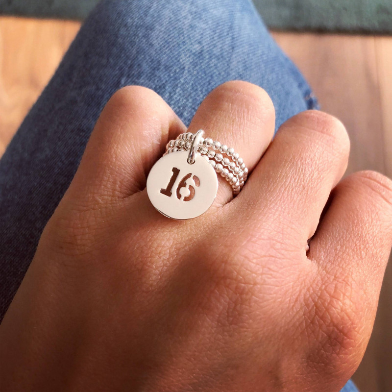 Perforated number medal on triple beaded ring