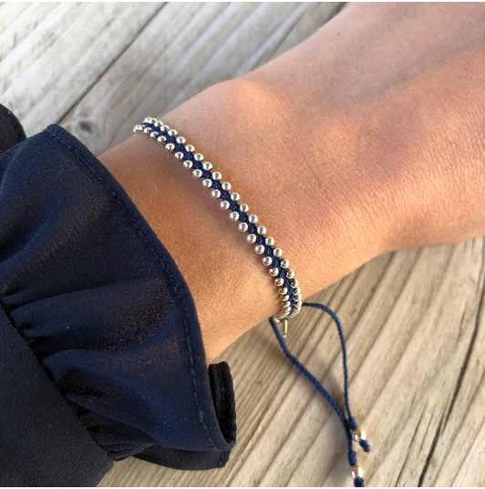 Navy blue braided bracelet with beads